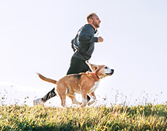 Man runs with his dog