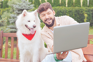 man holding dog for a virtual call